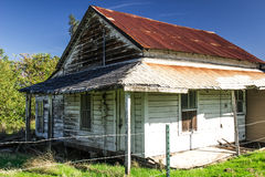 Old Tin Roof Building In Disrepair. Abandoned Tin Wood Home In Disrepair Royalty Free Stock Images