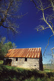Old tin roofed barn. A old tun roffed barn and blue sky Stock Photography