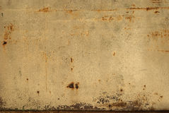 Old tin rusty wall. Old tin rusty stain wall as background royalty free stock photography