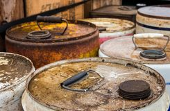 Old Tin Tops. Tops areas of some old chemicals containers with handles royalty free stock image