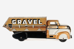 Old Tin Truck Toy. Vintage tin truck toy isolated on a white background Royalty Free Stock Photos