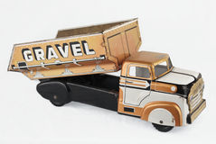 Old Tin Truck Toy. Vintage tin truck toy isolated on a white background Stock Image