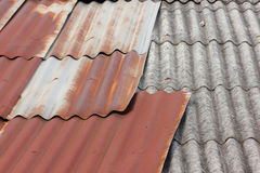 Old tins roof and old tiles roof Royalty Free Stock Photo