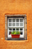 Old tiny windows in 6th century cottage Royalty Free Stock Photo