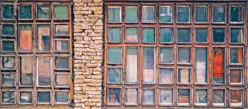 Old tiny windows. With paint peeled Stock Photo