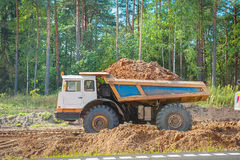 Old tipper vith clay ground in forest Royalty Free Stock Photography