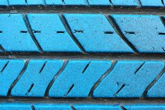 Old tire on blue color Royalty Free Stock Photography