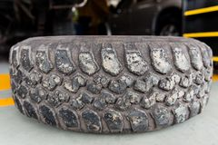 Old tire crack rubber truck dirty in garage stock photo