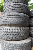 Old tire discard. Old black tire stack discard Royalty Free Stock Photos