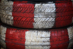 Old tire painted by red and white Royalty Free Stock Photos