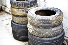 Old tire. Stack near the wall Royalty Free Stock Image