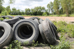 Old tire wheels. Old tire wheels,pile is kept outdoors for the sake of destruction royalty free stock images