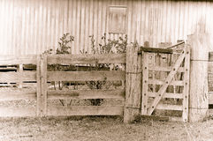 Old tired farm gate in sepia Stock Photos