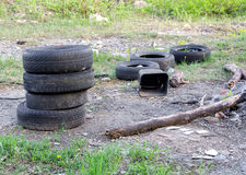 Old tires in forest Stock Image