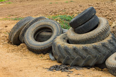 Old tires on the ground Royalty Free Stock Image