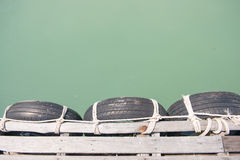 Old tires at local port in Phuket, Thailand Stock Image