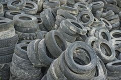 Old tires in piles. Old used tires in a recycling plant stock photography