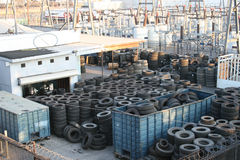 Old tires and power plant. Old used tires warehouse and power plant Stock Images