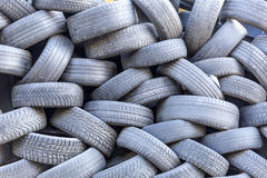Old tires stacked ready for recycling.  royalty free stock images