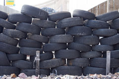 Old tires stacked to form a barricade Royalty Free Stock Photography