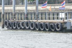 Old tires used to protect the boat. royalty free stock photos