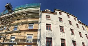 Old to new, Wilhelminian style old residential building, facades before and after renovation royalty free stock image