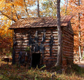 Old Tobacco Barn. An old log tobacco barn, no longer in use. A realic of another time stock photo