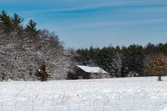 Old tobacco barn in winter at Northwest Park stock photography