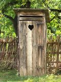 Old toilet. (WC) made of wood with heart on the door Royalty Free Stock Photos