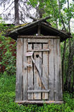 Old toilet. Outside in the garden of a farmhouse in swedish lapland royalty free stock photography