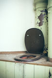Old toilet Stock Images