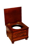 Old toilet with chamber pot an wooden chair Royalty Free Stock Photos