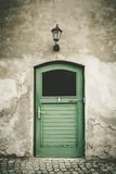 Old toilet door Stock Photography