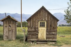 Old cabin and Toilet in California. Old toilet and shed at Laws near Bishop in California Royalty Free Stock Photography