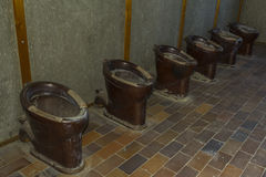 Old toilets in Dachau Concentration Camp, Germany Stock Image