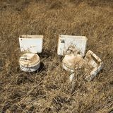 Old toilets in field. Stock Images