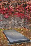 Old Tomb in the Autumn Cemetery Royalty Free Stock Image