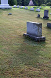 Old Tombstone. An old tombstone casting a shadow Royalty Free Stock Photos