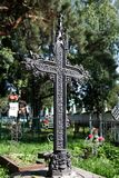 Old tombstone gothic cross Stock Photography