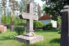 Old Tombstone in Shape of Cross at Cemetery Royalty Free Stock Photos