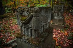 Old tombstones in abandoned cemetery.  Stock Photos