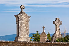 Old tombstones at antique european cemetery Royalty Free Stock Images