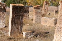 Old cemetery at lake Van, Anatolia, eastern Turkey. Old tombstones of a cemetery at lake Van in eastern turkey royalty free stock photography
