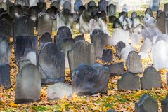 Old Burying Grounds in Boston, Massachusetts. Old tombstones mingle with the fallen leaves in the cemetery, Boston Massachusetts Stock Image