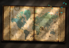 Old Tome with World Map Royalty Free Stock Image