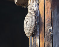 Old tool hanging on the hut. An old tool hanging on the hut Stock Photo