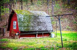 Old Tool Shed. An old tool shed covered in moss nestled on the edge of a spring forest in the Blue Ridge Mountains of Asheville, North Carolina stock images
