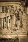 Old tool shelf against a wall vintage style Stock Photos