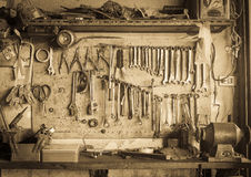 Old tool shelf against a wall vintage style Stock Image