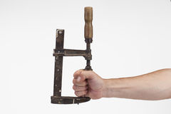 Old tool tightens hand Stock Photos